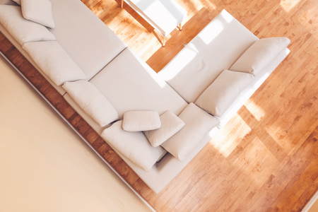 White sectional couch in a large luxury interior home