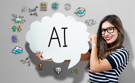 AI text with young woman holding a speech bubble Stock Photo
