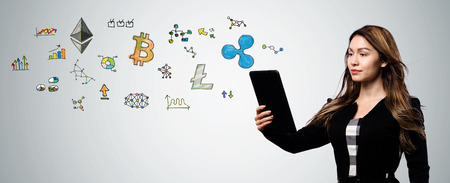 Cryptocurrency with businesswoman holding a tablet computer