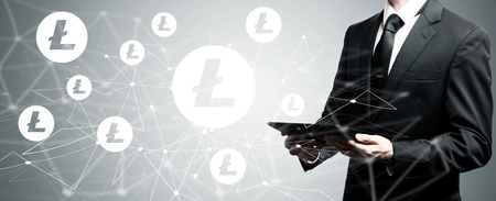 Litecoin with man holding a tablet computer Stok Fotoğraf