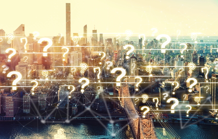 Question Marks with the New York City skyline near Midtown Stock Photo