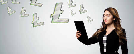 Litecoin with businesswoman holding a tablet computer