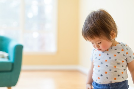 Toddler boy in his bright naturally lit house Stock fotó