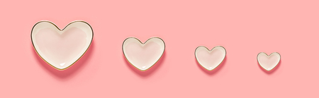 Pink heart dishes on a pastel pink background