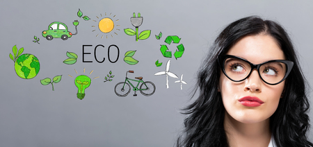 Eco with young businesswoman in a thoughtful face