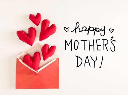 Mother Day message with red heart cushions coming out of an envelope
