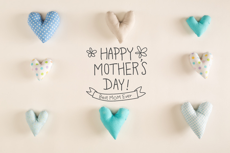 Mothers Day message with blue heart cushions on a white paper background Stock Photo - 99310137