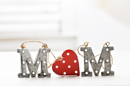 Mom letter ornaments on a table in a room Stock Photo