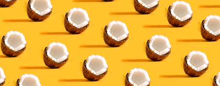 Series of coconuts on a yellow background