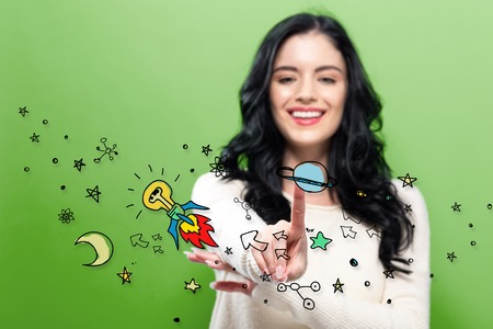 Idea Rocket with young woman pointing on a green background