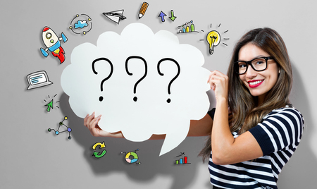 Question Marks text with young woman holding a speech bubble