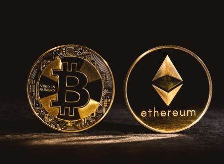 Bitcoin and Ethereum coins on a dark background