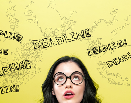 Deadline with young woman on a yellow background Banco de Imagens