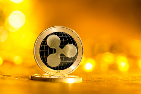 Ripple cryptocurrency coin on a bright gold background Standard-Bild