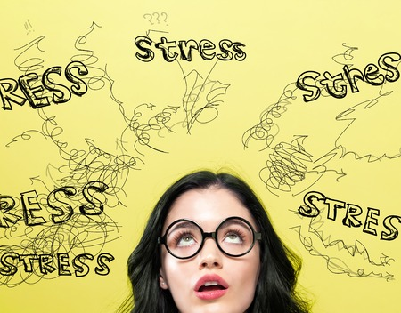 Stress with young woman on a yellow background Stock Photo