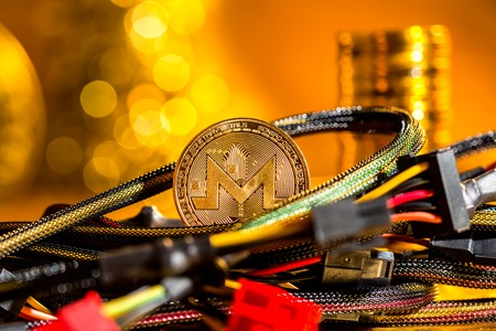 Monero cryptocurrency coin with compute wires on a golden background