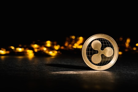 Ripple cryptocurrency coin on a dark background Zdjęcie Seryjne