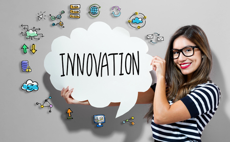 Innovation text with young woman holding a speech bubble