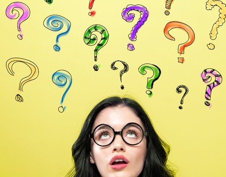 Question Marks with young woman on a yellow background