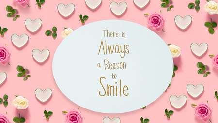 There Is Always A Reason to Smile message with pink roses and hearts Stock Photo