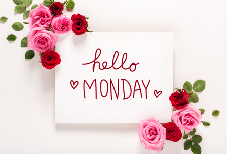 Hello Monday message with roses and leaves top view flat lay