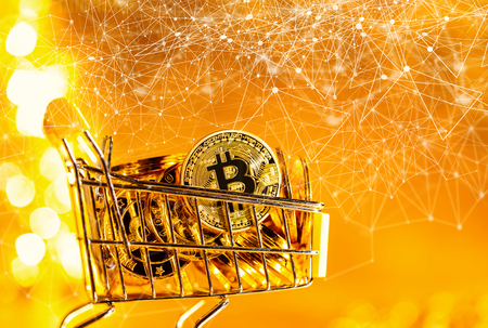 Bitcoin cryptocurrency coins with shopping cart consumer spending theme Фото со стока