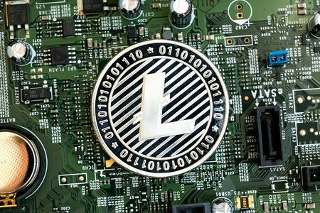 Litecoin cryptocurrency coin on a computer chip