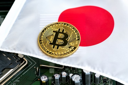 Bitcoin cryptocurrency coin on a Japanese flag Zdjęcie Seryjne