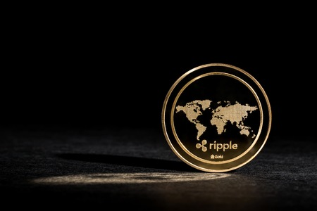 Ripple cryptocurrency coin on a dark background 版權商用圖片