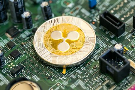 Ripple cryptocurrency coin on a computer chip Zdjęcie Seryjne - 100134661