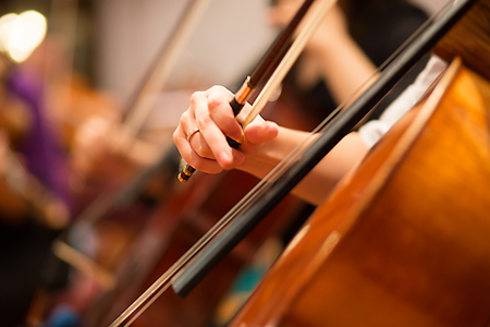 Cello player performing in a symphony orchestra Stock Photo