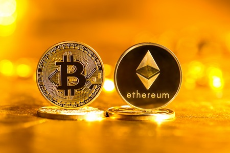 Bitcoin and Ethereum coins on a gold background