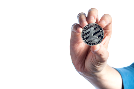 Litecoin cryptocurrency coin held by a man on a white background