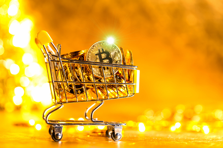 Bitcoin cryptocurrency coins with shopping cart consumer spending theme 版權商用圖片