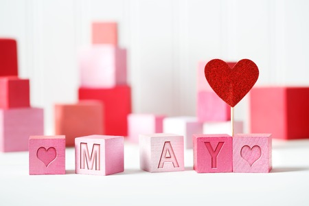 May theme with pink and red wooden blocks