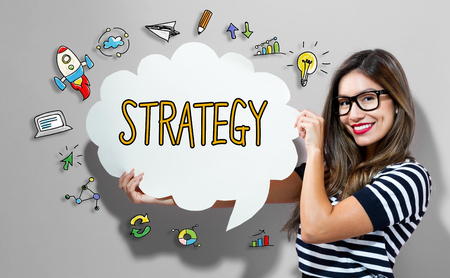 Strategy text with young woman holding a speech bubble Imagens