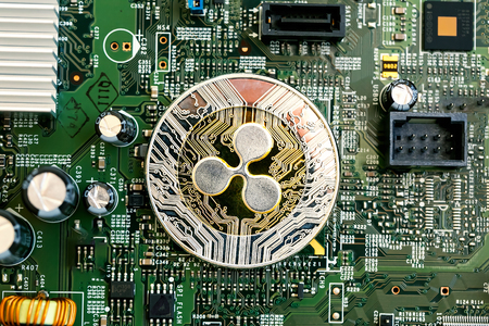 Ripple cryptocurrency coin on a computer chip
