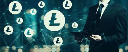 Litecoin with businessman holding a tablet computer Stock Photo - 100543548