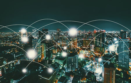 Network and connection technology concept with aerial view of Tokyo, Japan at night Stock Photo