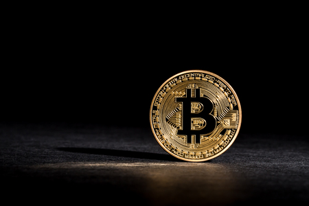 Bitcoin cryptocurrency coin on a dark background
