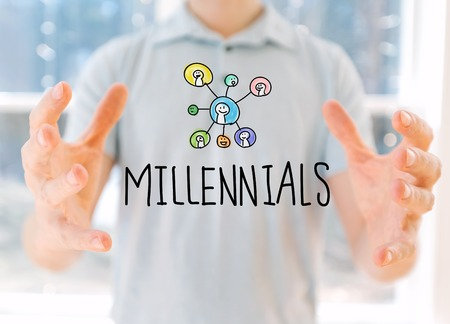 Millennials with young man holding his hands Stock Photo