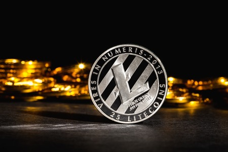 Litecoin cryptocurrency coin on a dark background