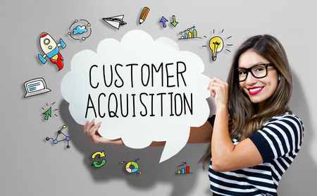 Customer Acquisition text with young woman holding a speech bubble