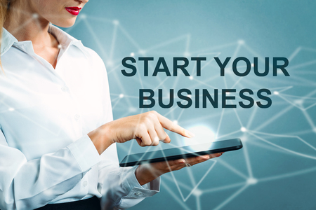 Start Your Business text with business woman using a tablet