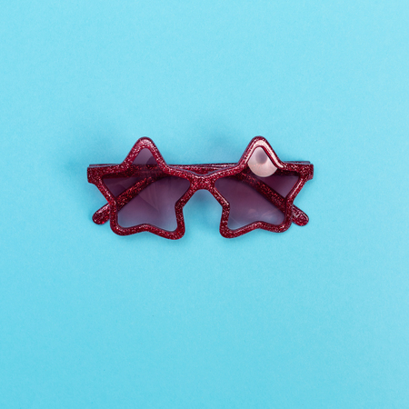 Cool sunglasses on a baby blue background, top view Stock Photo