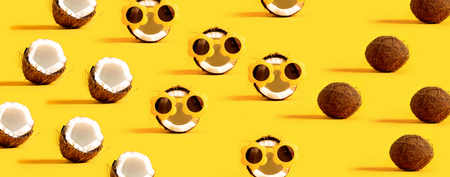 Series of coconuts wearing sunglasses on a yellow background Stock Photo