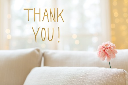 Thank You message with a flower in a bright interior room sofa