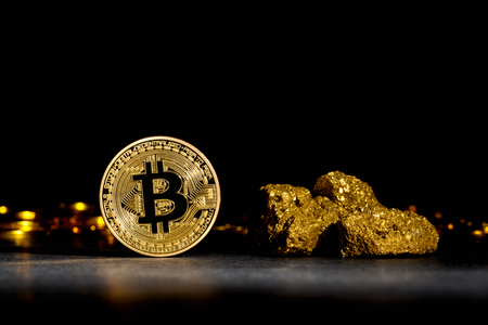 Bitcoin cryptocurrency coin with gold nuggets on a dark background