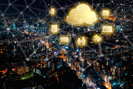 Cloud Computing with aerial view of Tokyo, Japan at night Stock Photo
