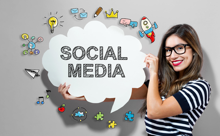 Social Media text with young woman holding a speech bubble Imagens